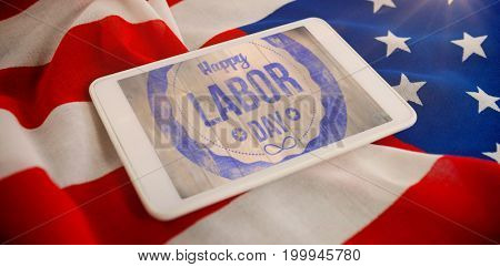 Blurry animated flare against tablet computer on crumbled american flag