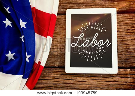 Blurry animated flare against american flag and tablet computer on table