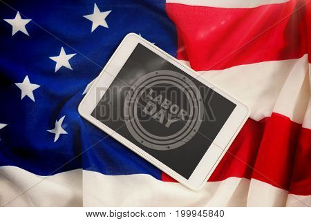 Blurry animated flare against tablet pc on american flag