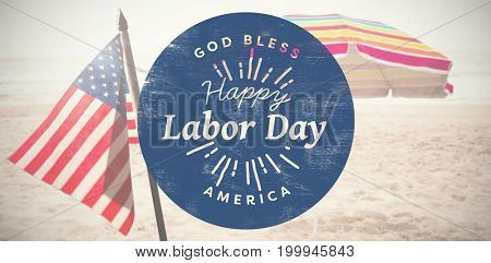 Happy labor day text on blue poster against beach umbrella at tropical sand beach