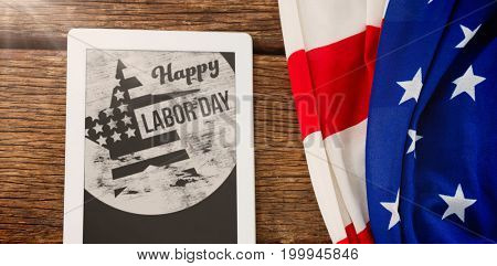 Flare against american flag and tablet computer on table