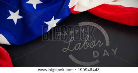 Digital composite image of happy labor day text with blue outline against american flag on blank slate