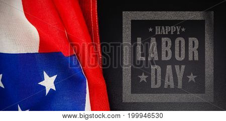 Composite image of happy labor day poster against american flag and blank slate on wooden table