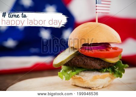 Digital composite image of time to happy labor day text against burger on plate against american flag