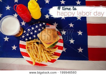 Digital composite image of time to happy labor day text against hamburger in plate on american flag