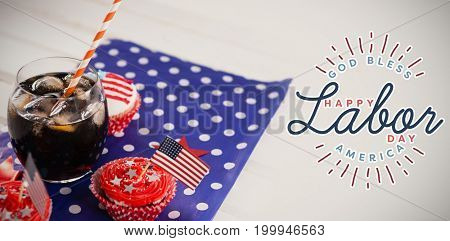 Composite image of happy labor day and god bless America text against decorated cupcakes with drink on paper