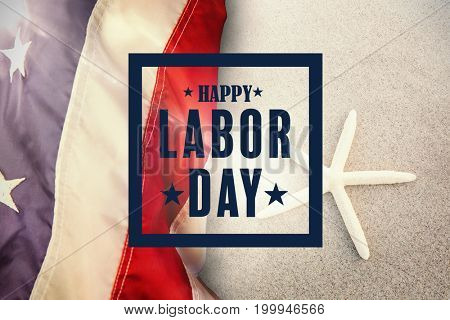 Composite image of happy labor day poster against starfish kept on sand