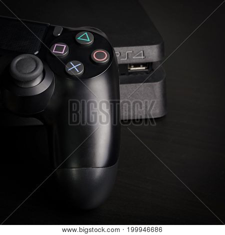 Sankt-Petersburg, Russia - 14 August, 2017: Sony PlayStation 4 Slim 1Tb revision and game controller