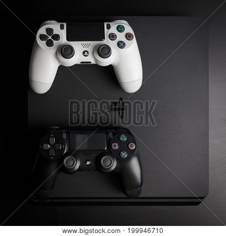 Sankt-Petersburg, Russia - 14 August, 2017: Sony PlayStation 4 Slim 1Tb revision and game controllers