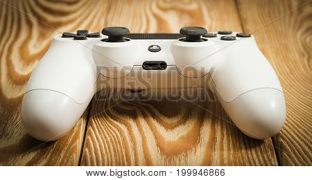 Sankt-Petersburg, Russia - 14 August, 2017: Sony PlayStation 4 Slim 1Tb revision game controller on the wood table