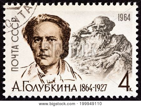 USSR - CIRCA 1964: A stamp printed in USSR issued for the birth centenary of Anna Semyonovna Golubkina shows sculptor Golubkina (after N. Ulyanov) and Tolstoy statue, circa 1964.