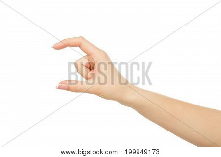 Female hand measuring invisible item, close-up, cutout, isolated on white background.