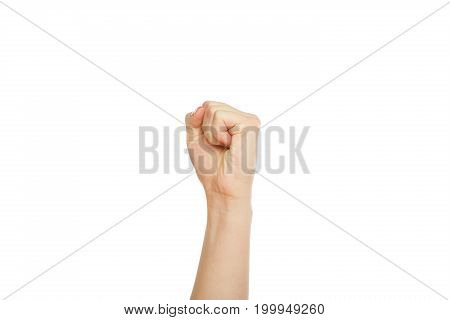 Female hand clenched fist, ready to punch, close-up, cutout, copy space, isolated on white background.
