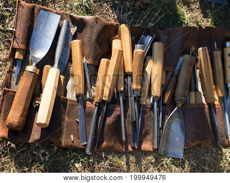 Carving woodcutting chisels. Sculptural chisels for making statues of wood. Set of and-made steel tools for making sculptures such as Bethlehems and Artwork. Equipment for arts and crafts, woodwork.