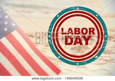 Labor day text in circles against starfish with sea shells and a bottle of sunscreen lotion on sand