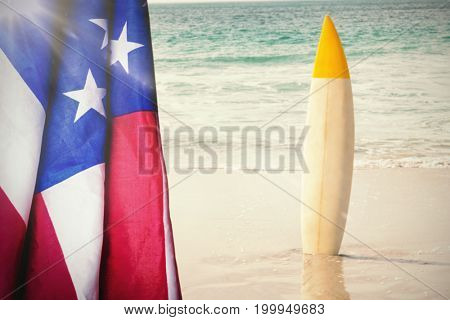 Flare against surfboard in sand