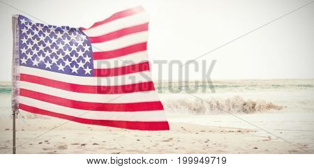 Flare against scenic view of waves on seashore