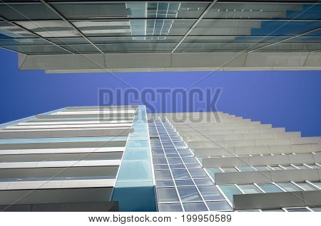 Glass  and cement  of one skyscraper on blue sky background