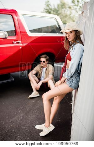 Couple Posing Next To Vintage Car