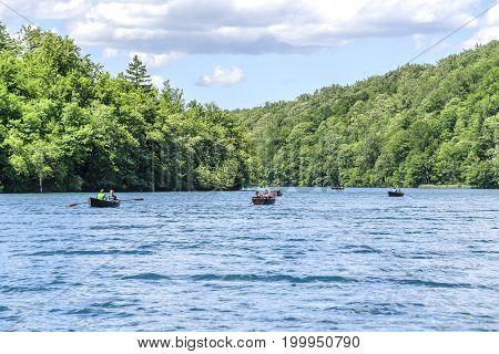 CROATIA PLITVICE, 29 JUNE 2017: Tourists ride on pleasure boats on Lake Kazyak, in the national park Plitvice Lakes.