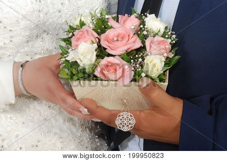 Groom and bride hands flower ring couple