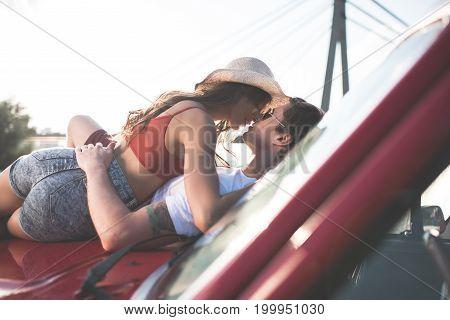 Couple Kissing On Car Hood