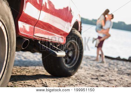 Car And Couple On Beach