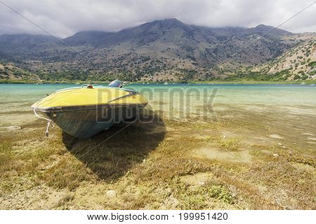 Old boeat on the mountain lake kournas in Crete, Greece.