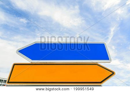 empty arrow traffic sign (bidirectional) pointing to different sides (left / right) - blue sky