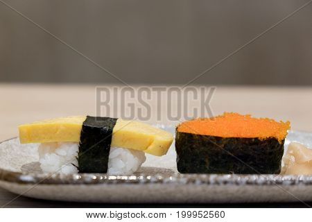 Close Up big sushi shrimp eggs and egg sushi tamago sushi