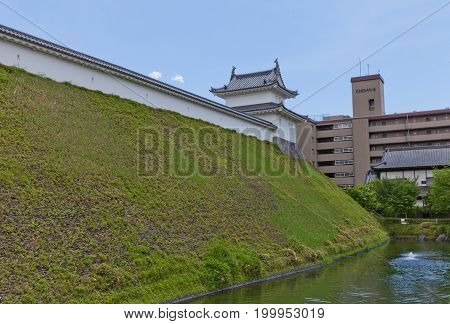 UTSUNOMIYA JAPAN - JUNE 2 2017: Reconstructed moat earthen wall (dorui) and Fujimi Turret of Utsunomiya Castle Japan. Castle was founded in 1062 destroyed in War of 1868 and reconstructed in 2007