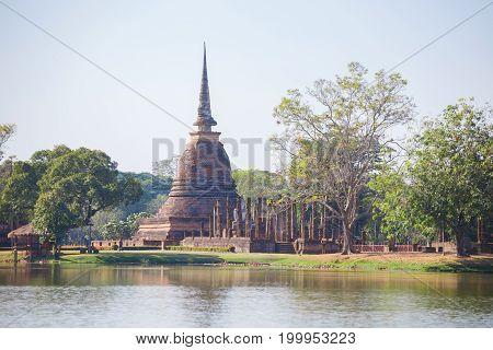 Ancient buddha statue and pagoda at Sukhothai Historical Park Sukhothai Province Thailand.