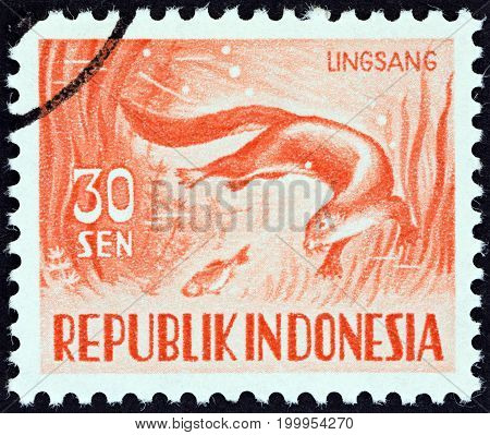 INDONESIA - CIRCA 1956: A stamp printed in Indonesia shows Smooth-coated otter (Lutrogale perspicillata), circa 1956.