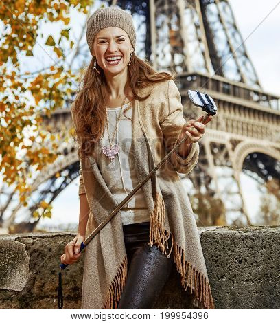 Tourist Woman With Selfie Stick On Embankment Near Eiffel Tower