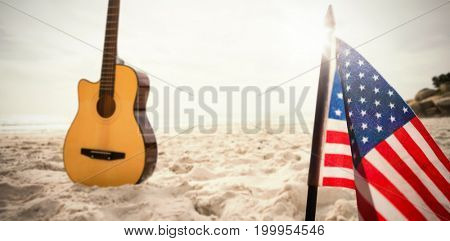 A white flash with a black blackground against acoustic guitar in sand