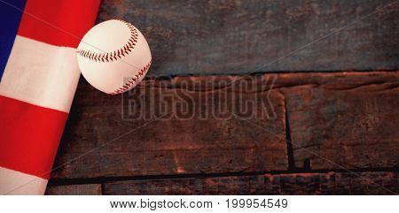 High angle view of baseball ball and American flag on wooden table