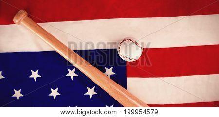 Close-up of baseball ball and bat on national flag