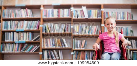 Cute disabled pupil smiling at camera in hall  against low angle view of various books on shelf