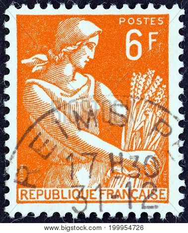 FRANCE - CIRCA 1954: A stamp printed in France shows Harvester, circa 1954.