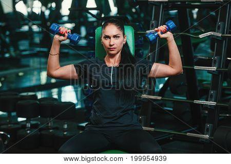 sport bodybuilding training - woman training in the gym