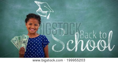 Digital image of back to school text against portrait of girl showing paper currency