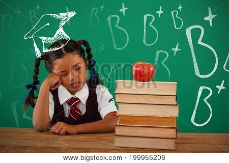 B plus doodle against unhappy schoolgirl looking at books stack and apple against chalkboard