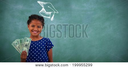 Graduation hat vector against portrait of girl showing paper currency