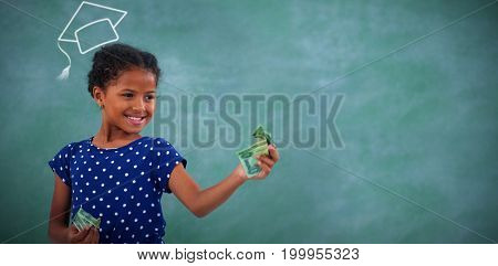 Graduation hat vector against smiling girl looking at paper currency