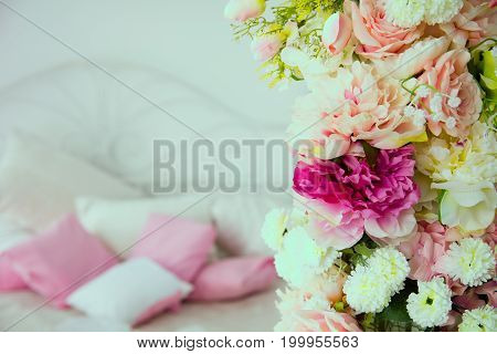 Close-up Of A Flower Garland On The Background Of Pillows