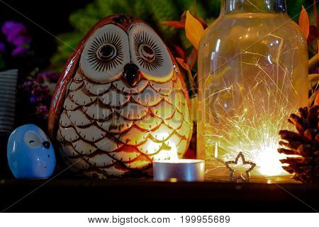 Parklers In Glass Jar At Night With Owl Doll.