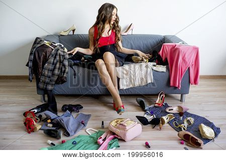 Girl can't decide what clothes to wear