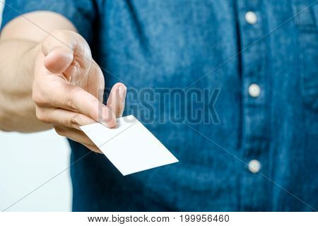 Man In Jeans Shirt Showing Blank White Business Card For You To Give