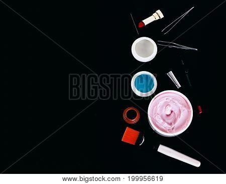 Various Cosmetics: Cream, Gel, Lipstick, Lip Liner, Brushes And Tweezers