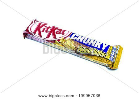 Kota Kinabalu Malaysia - August 16 2017: Kit Kat Chunky Peanut Butter flavored isolated on white background. Kit Kat bars are produced by Nestle. Brand Kit Kat was registered in 1911.